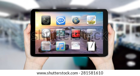 Modern digital tactile tablet on blurred office background - stock photo