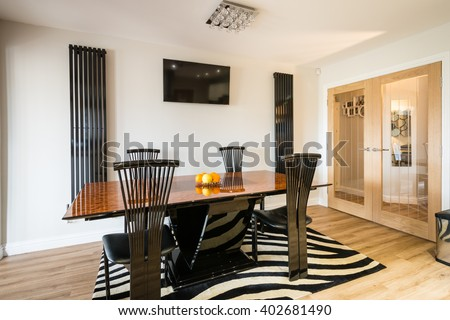 Modern Dining Area / A contemporary dining area in a large Kitchen Diner Room with wall mounted tv and radiators