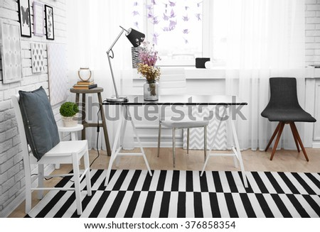 Modern dining room interior in black and white tones - stock photo