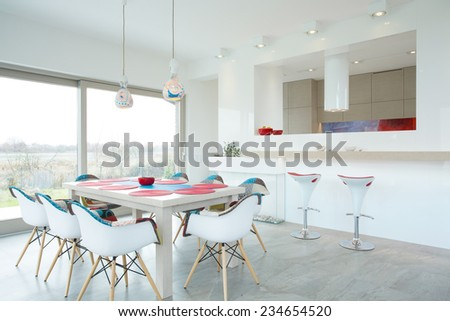 Modern dining room interior with color elements - stock photo