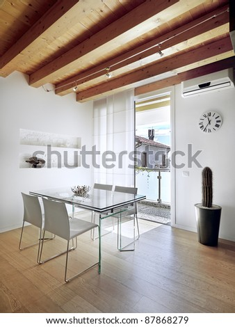 modern dining room overlooking  the balcony with ceiling and floor of wood - stock photo