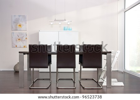 Modern Dining-Room with brown leather chairs - stock photo