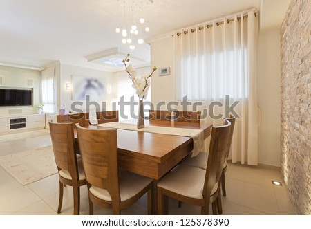 Modern dining room with decorative wall and HD TV - stock photo