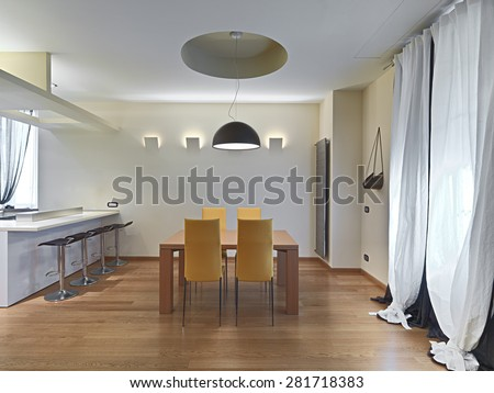 modern dining room with yellow leather chairs and wooden table, floor nade of parquet.