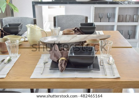 modern dining set on wooden table