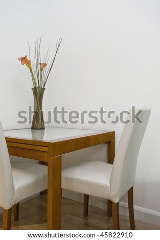 modern dining table detail with cut flowers - stock photo