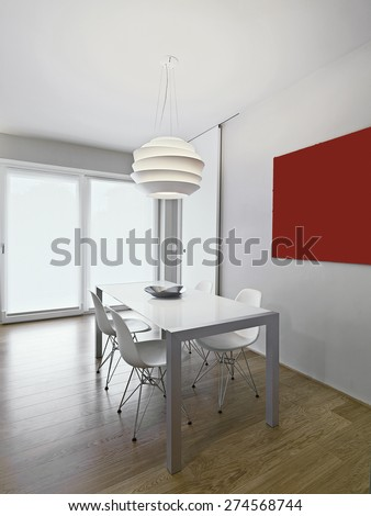 modern dining table in the living room with wood floor and chandelier