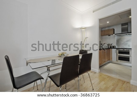 modern dining table with seats for six and open plan kitchen view