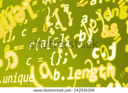 Modern display of data source code. Programming code abstract screen of software developer. Computer script. Green yellow orange color. - stock photo