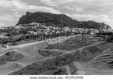 Modern districts of San Marino and Italian suburban hills.Black and white photography. - stock photo