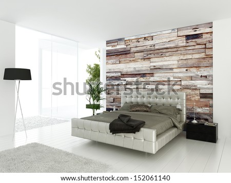 Modern double bed standing against wooden wall - stock photo