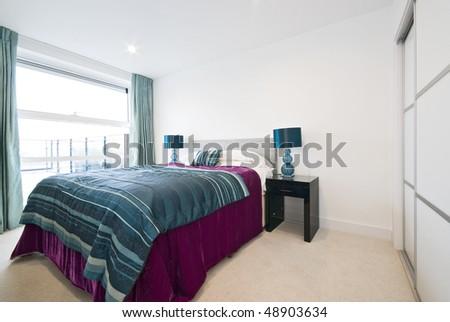 Modern double bedroom - stock photo