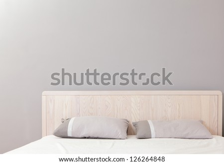 modern double bedroom with gray wall, great for copy space - stock photo
