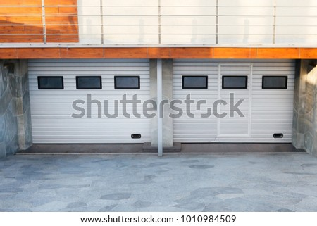 Modern Double White Garage Doors Luxury Stock Photo Download Now