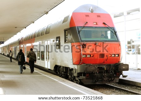 Modern doubledeck train on a platform - stock photo