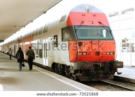 Modern doubledeck train on a platform - stock photo