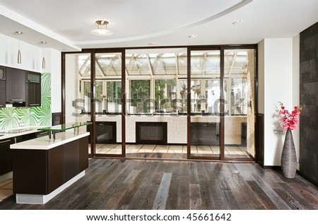 Modern drawing room (studio) and kitchen interior with balcony and dark wooden floor, front wide angle view