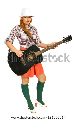 Modern dressed woman playing guitar isolated on white background