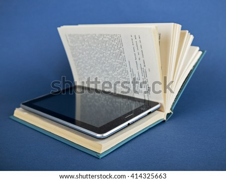 Modern ebook reader in traditional book  on a blue background