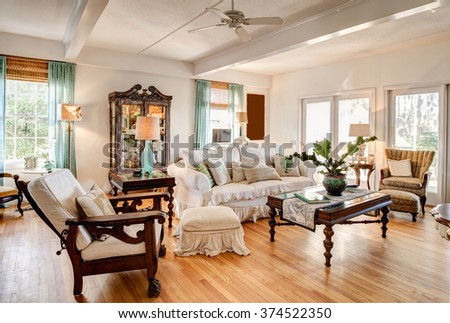 Modern eclectic livingroom with nice antique furniture. - stock photo