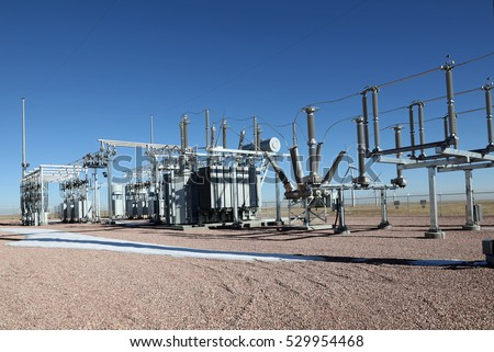 Modern electric substation with high voltage, transformers, and distribution equipment.
