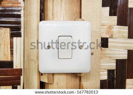 Modern electrical switch of country hut.