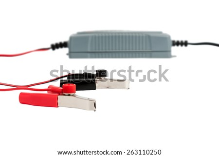 Modern electronic charger for car battery isolated on white background - stock photo