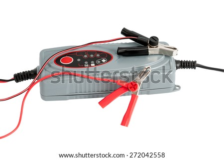Modern electronic charger for car battery with terminals and jumper cables isolated on white background - stock photo