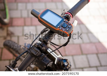 Modern electronic gps device attached to bicycle handlebar - stock photo