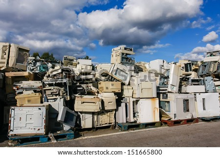 Modern electronic waste for recycling or safe disposal, any logos and brand names have been removed. Great for recycle and environmental themes. - stock photo
