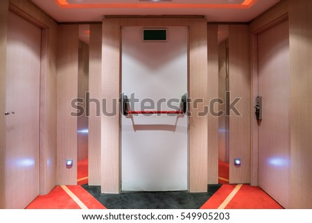 modern Emergency exit door, Exit sign for stairway Building Emergency Exit with Exit Sign on door and Fire Extinguisher