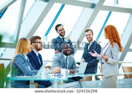 Modern employees voicing their opinions upon new ideas - stock photo