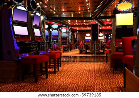 modern empty casino hall with game machines, front view - stock photo