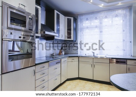 modern empty kitchen with stainless still appliances. - stock photo