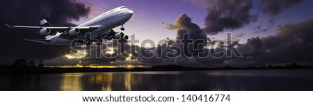 Modern 4 engine airliner banner set on a sunset sky with nice river reflection. - stock photo
