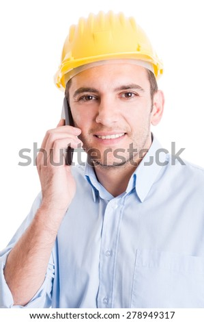 Modern engineer talking on smartphone and wearing yellow helmet