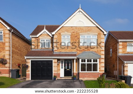 Modern english detached house with garage - stock photo