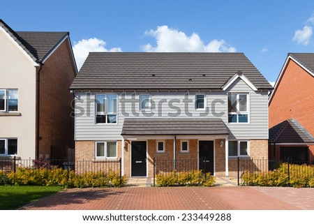 Modern english house on exclusive estate - stock photo