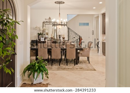 Modern Entrance Hall Lobby With The Stylish Wooden Door And Dining Room At Back