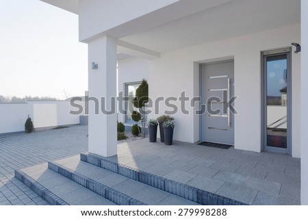 Modern entrance to the big white house - stock photo