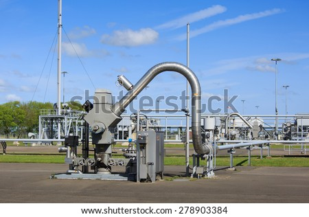 Modern equipment at a natural gas processing site. Gas production causes earthquakes in Groningen, Holland. - stock photo