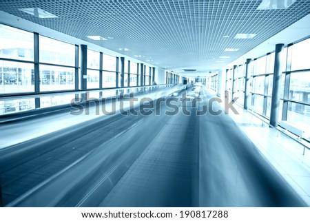 Modern escalator in airport, motion blur - stock photo