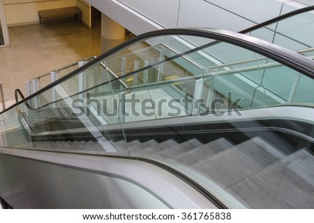 Modern escalator. Side view from top to down - stock photo