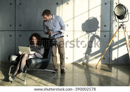 Modern European couple with books relaxing at home