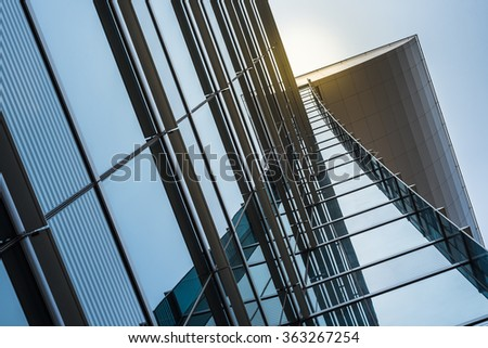 modern facade design with glass and steel of high rise building - stock photo