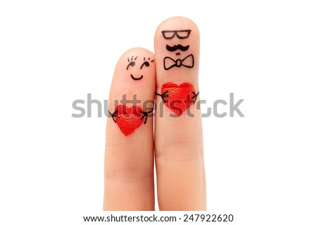 modern family concept valentine's day - a hipster man and a woman hold on the red hearts, painted at fingers and isolated on white background - stock photo