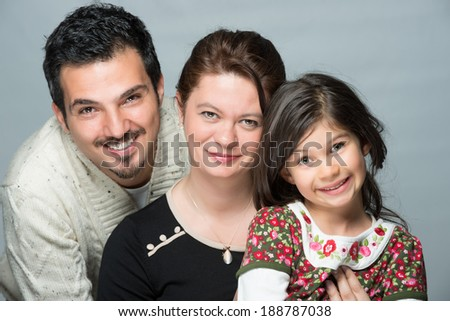 Modern family father mother and daugter smiling - stock photo