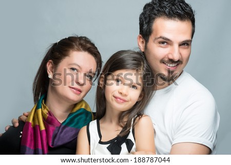 Modern family father mother and daugter smiling