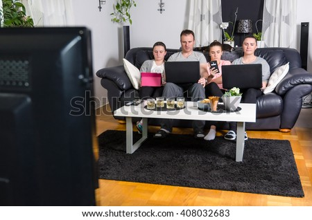 Modern family in front of tv