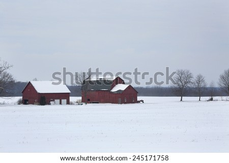 Modern farm in surrounded by the snow-covered fields of Western New York.  - stock photo